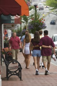 Couple walks arm in arm in Downtown Blacksburg