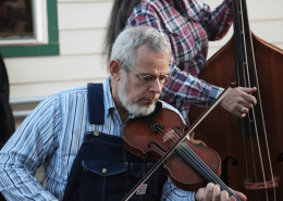courtesy of the Washingtonian Floyd County Resident wearing overalls plays the fiddle outside the Floyd Country Store