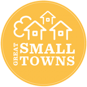 Yellow Great Small Towns Logo with houses and a comfortable feel. Given to Floyd County, VA a great small town near DC